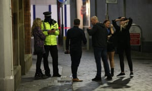 Police talk to people in Liverpool on the last weekend before stricter lockdown measures are expected across the north. Last weekend before pub closures, Liverpool, UK, 10 October 2020