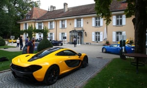 A F McLaren P1 Coupe arrives for auction at the Bonmont Golf and Country Club.
