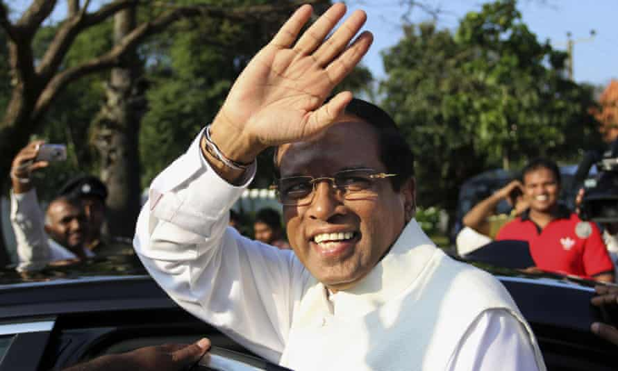 Sri Lanka's president-elect Maithripala Sirisena gestures as he leaves after casting his vote during the presidential elections at a polling station in Polonnaruwa, about 200 kilometers (124 miles) northeast of Colombo, Sri Lanka.