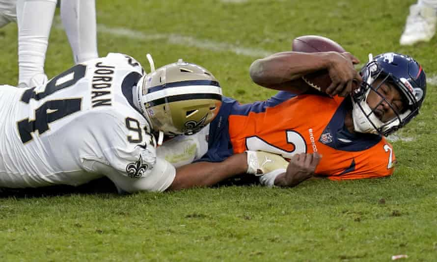 Kendall Hinton (right) at the sharp end of the Broncos' quarterback crisis.
