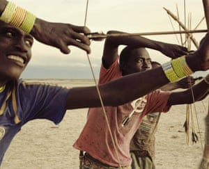 Young Hadza men test their daily hand-made arrows