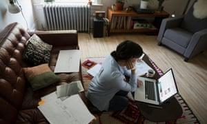 Female architect using laptop in living room