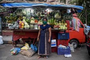 Mumbai, India: Lalita Kesharwani, 41, vegetable vendor