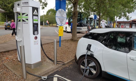 An electric car charging at motorway service station.
