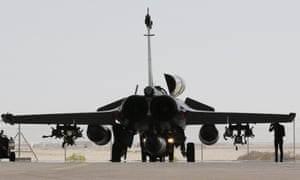 A French army fighter jet sits on the tarmac at a military base as France launched airstrikes on Syria.