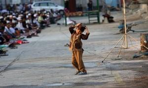 A boy attends Eid al-Fitr prayers