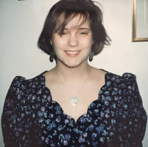 A young Susan Calman in a blue floral dress with a scalloped neckline.