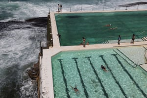 Sydney, Australia People soak up the sun at an oceanside swimming pool by Bondi beach on the first official day of summer