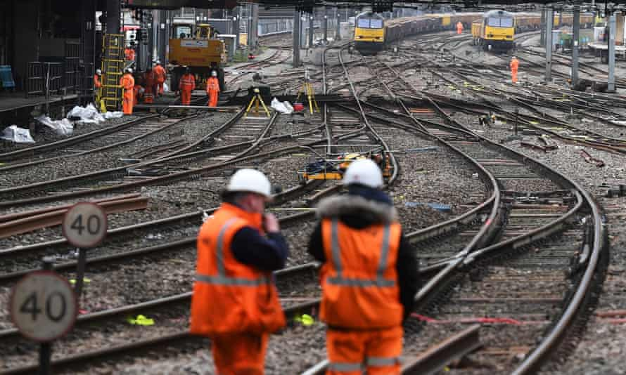 Network Rail staff work on tracks at a closed Paddington station in London in 2016.