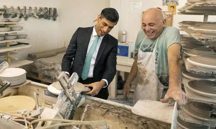 Chancellor of the exchequer Rishi Sunak handling clay while visiting the Emma Bridgewater pottery in Stoke-on-Trent.