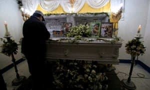 A mourner stands by the coffin of a man killed in an anti-drug operation in Manila, philippines.