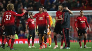 The United players walk off at the end of the match.