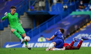 Kepa Arrizabalaga clears the ball as Andreas Christensen gets up from dragging down Sadio Mané