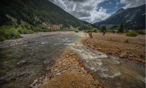 The contaminated Cement Creek in Silverton, Colorado, where it joins the Animas River on the left. The creek is a tributary that was heavily contaminated with wastewater from the Gold King mine.
