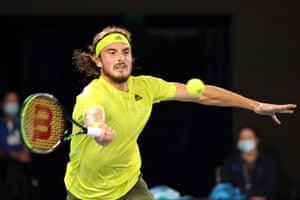 Tsitsipas hits a return against Nadal.