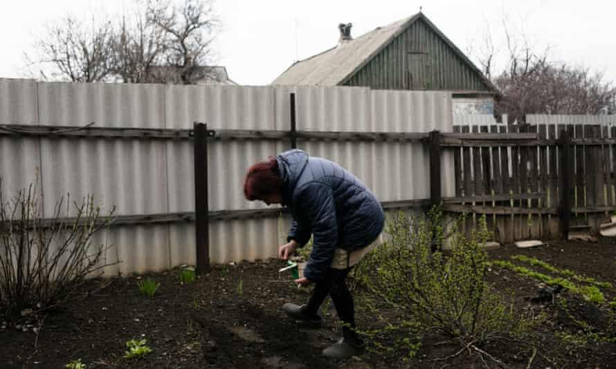Svitlana Derkach tending her garden in Marinka.