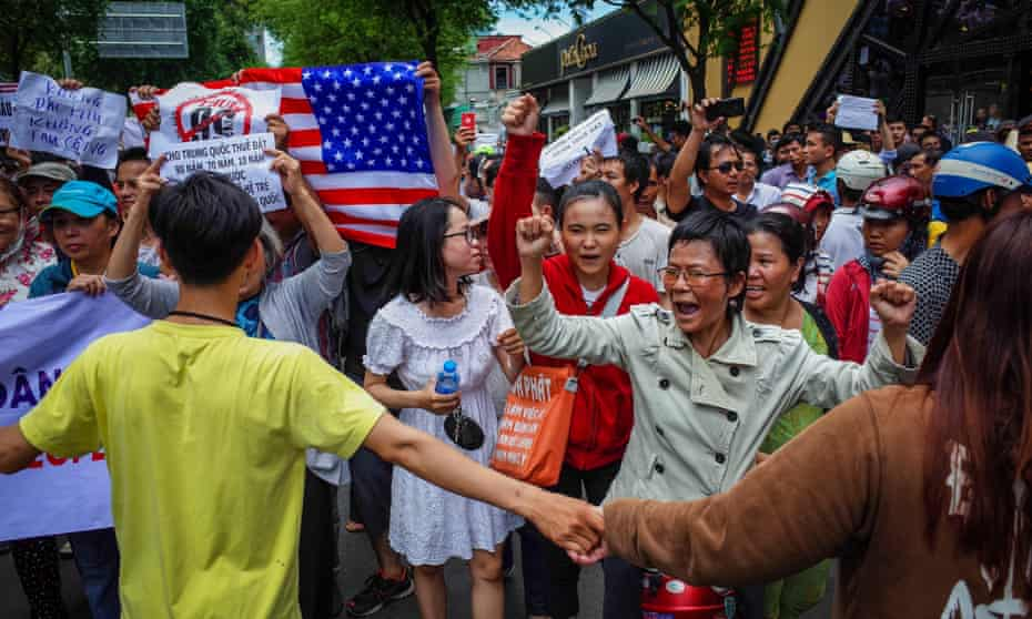 Vietnamese protesters demonstrate in Ho Chi Minh city on Sunday against a proposal to grant companies lengthy land leases.
