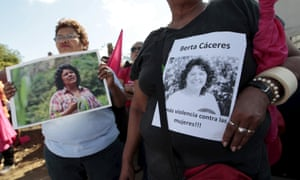 Activists hold photos of Berta Cáceres during a march in Managua.