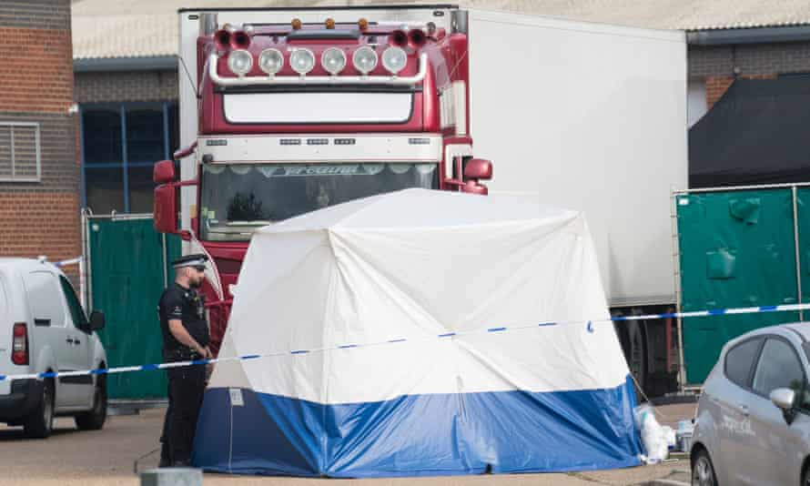 Essex police with the refrigerated trailer where 39 bodies were found on 23 October