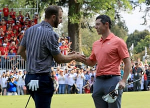 Dustin Johnson shakes hands with Rory McIlroy after his five shot victory.