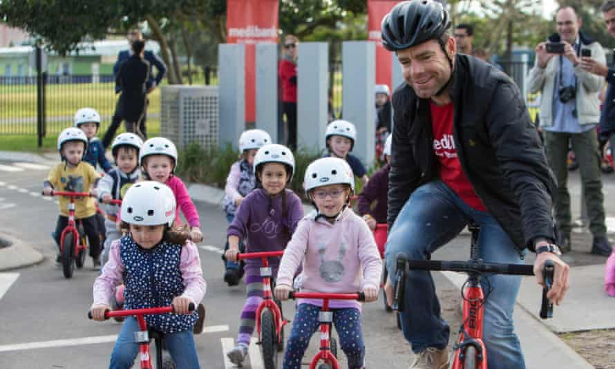 Cadel Evans takes a group of children for a bike ride in Heffernan Park in Sydney