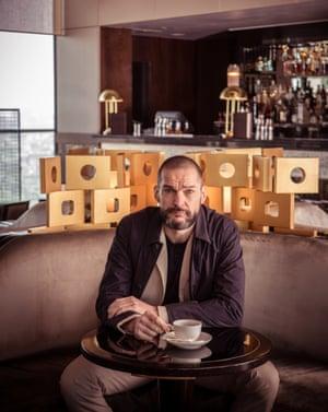 Fred Sirieix sitting in his restaurant