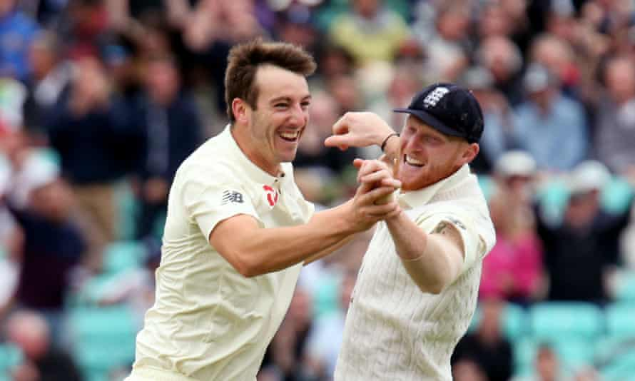 Toby Roland-Jones celebrates the dismissal of Heino Kuhn, his second South African wicket, with Ben Stokes.