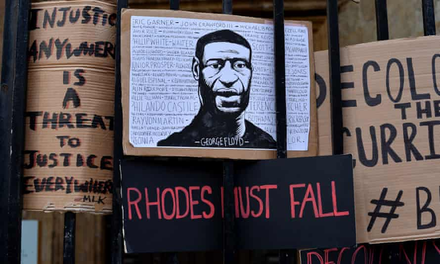 Placards left by protesters demanding the statue of Cecil Rhodes be removed from Oriel College, Oxford.