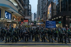Riot police put up a warning flag during an anti-government protest on September 6, 2020 in Hong Kong, China.