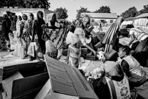 Mothers queue for cereal supplies in Gwoza IDP camp