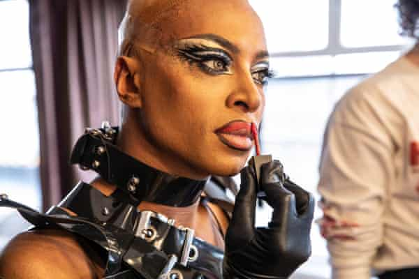 Tayce, one of RuPaul's Drag Race Drag Queens, puts lipstick on, preparing for a shoot, March 2021