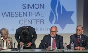 Hikaru Kimura bows in apology at the Simon Wiesenthal Center in Los Angeles on Sunday. James Murphy, a 94-year-old forced labor survivor, is far right.