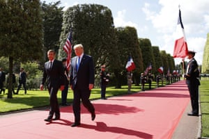 Presidents Donald Trump and Emmanuel Macron arrive for a ceremony at the Normandy American Cemetery and Memorial