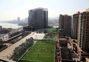 A football pitch built on the rooftop of a shopping centre in Jinhua city, China offering a location for office workers to play in the heart of the city