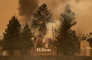 Smoke continues rises from the Hilton Sonoma Wine Country in Santa Rosa, California, during the Tubbs fire in 2017.