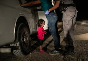 World press photo of the year. A two-year-old Honduran asylum seeker cries as her mother is searched and detained near the US-Mexico border.