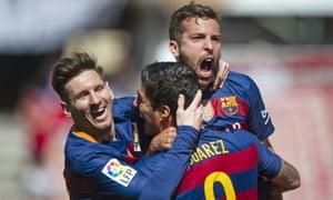 Lionel Messi, left, and Jordi Alba congratulate Luis Suárez on scoring at Granada, where the Uruguayan's hat-trick won Barcelona the title.