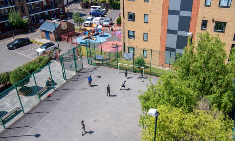 Young people playing football on the Elim estate in Bermondsey, south London