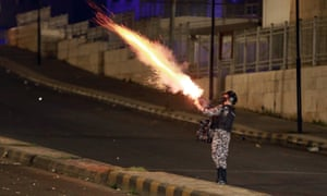 Jordanian security forces disperse a protest in Amman over measures imposed by authorities to curb the spread of coronavirus. Protesters clashed with police in Jordan's capital amid a second night of demonstrations against health restrictions, even as the country posted a record high number of coronavirus cases.