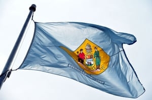 The state of Delaware flag flying at the Leonard L Williams justice center in Wilmington, Delaware.