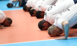 Players of Egypt react after beating Brazil in the sitting volleyball