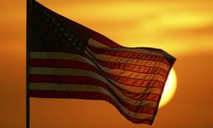 American flag sun setting
