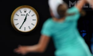 A clock shows the time at the Australian Open