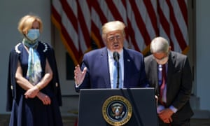 Trump in the White House Rose Garden with Deborah Birx and Anthony Fauci, who did not speak at the event.