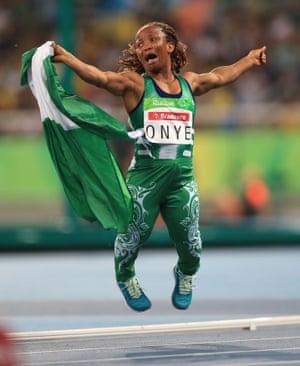 Nigeria's Lauritta Onye celebrates winning the shot put F40 final and setting a new world record