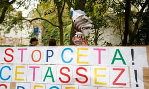 A placard reads 'Stop Ceta' outside the Walloon parliament in Namur, Belgium. The banner appears to have had its wish granted.