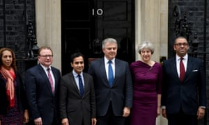 Theresa May and some of her team outside No 10.