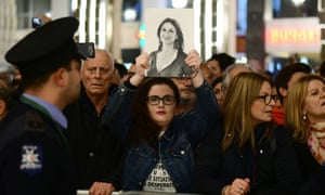 A protester holds up a picture of the killed journalist Daphne Caruana Galizia in Valletta.