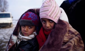 Children cross the Macedonia-Serbia border.