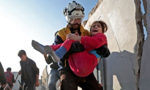 A member of the Syrian Civil Defence, also known as the White Helmets, carries a wounded girl after a reported Russian air strike in Idlib province